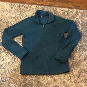 Birthplace teal fleece jacket.